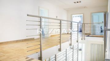 Freistehendes Einfamilienhaus inkl. Doppelgarage mit exklusiver Ausstattung und Gewerbeanteil