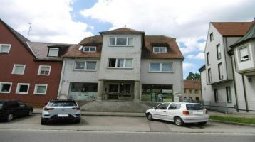Großzügiges Mehrfamilienhaus mit Ladeneinheit im Zentrum