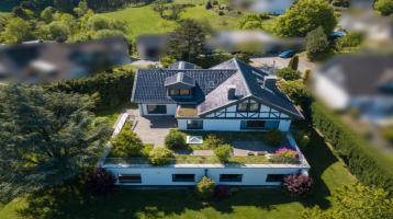 Mehrgenerationen-Wohnen in einem Zweifamilienhaus zzgl. Wellnessbereich in traumhaft grüner Wohnlage