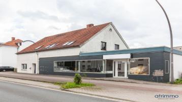Mehrfamilienhaus mit zwei Wohnungen, Ladenlokal, Garten und Ausbau-Reserve im Herzen von Hüllhorst