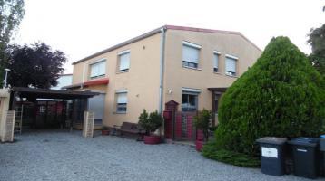Wohn- und Geschäftshaus im Gewerbegebiet in 79258 Hartheim-Feldkirch