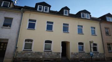Zweiseitiges angebautes Mehrfamilienhaus