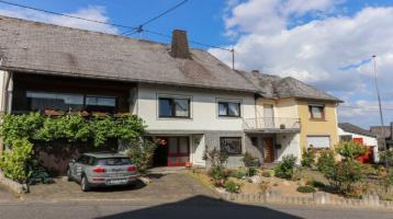 Zwei ineinadergehende Häuser. Vermietet! Für Investoren oder Eigennutzer + Vermietung geeignet!