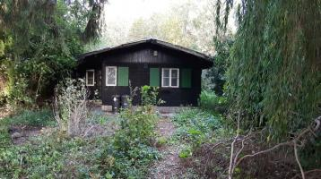 Freizeitgrundstück mit Holzhaus direkt am Feldmochingersee