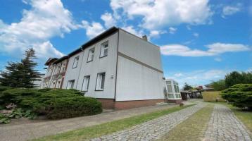 Doppelhaushälfte inklusive Einliegerwohnung, Seitenflügel und massivem Nebengelass in Oranienburg