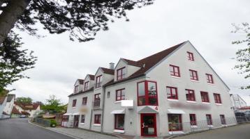 Lukratives Investment Modernes Mehrfamilienhaus mit Gewerbeeinheit in bester Ortskernlage