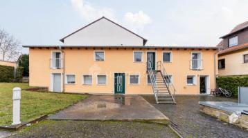 Voll vermietetes Mehrfamilienhaus mit 4 Wohneinheiten und Stellplätzen in Niederwerrn